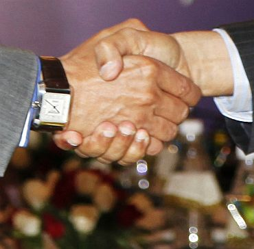 Home Secretary G K Pillai shakes hands with his Pakistani counterpart Chaudhary Qamar Zaman