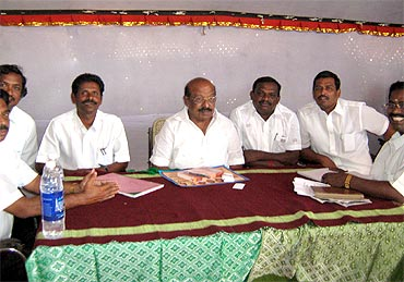 DMK's candidate from Palayamkotti TPM Mohideen Khan (centre) and his supporters
