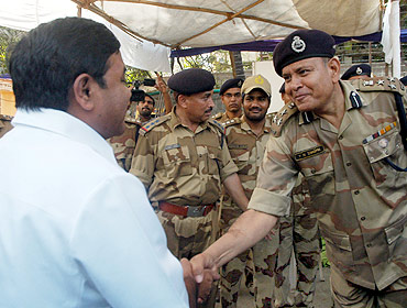 Home Minister RR Patil meets para-military forces deployed at the stadium