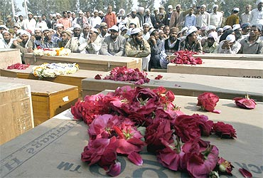 A file photo of the coffins of unidentified victims of the Samjhauta Express blast