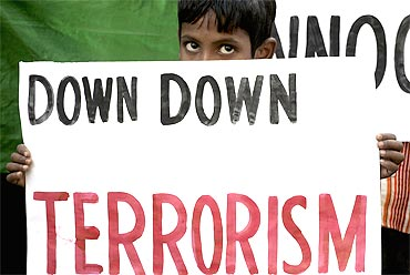 A boy participates in a demonstration to condemn the Samjhauta Express blast