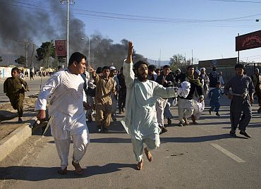 Afghans chant anti-American slogans during a demonstration to condemn the burning of the Quran