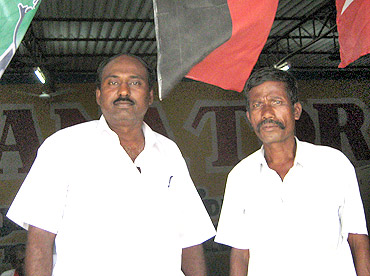 DMK district Councillor Sudhakar (left) with a party worker