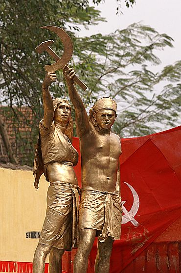 A tableau in a Communist rally in Kerala showing two farmers forming the hammer and sickle