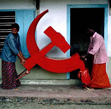 CPI-M activists carry a party prop