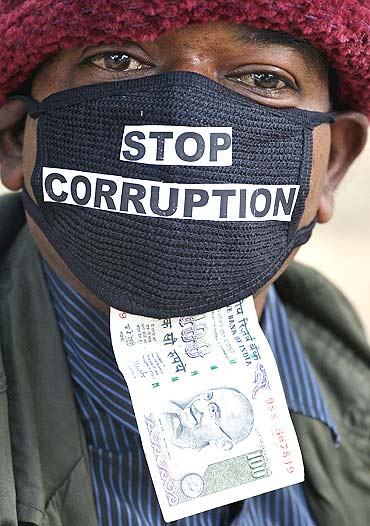 A villager participate in an anti-corruption rally