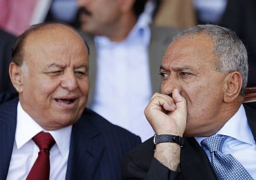 In this file picture, Yemen's President Saleh (right) listens to his deputy Mansur Hadi (left) during a gathering in Sanaa