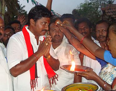 DMK candidate N Anand on the campaign trail in Srirangam