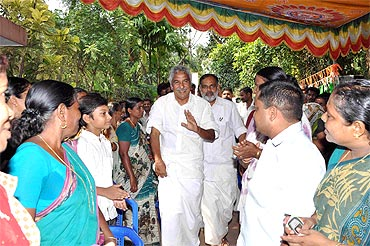 Chandy interacts with the public while camapaigning for K R Gowri Amma