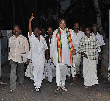 Congress MP Shashi Tharoor, accompanied by his supporters, campaigns in Thiruvanthapuram