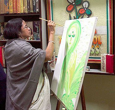 West Bengal Chief Minister Mamata Banerjee paints,