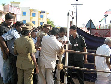 Security personnel conduct checks at the rally