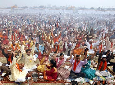 People perform yoga as part of prayers for world peace