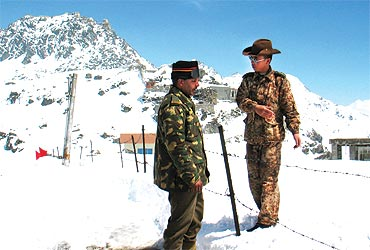 An Indian army officer talks with a Chinese soldier at the Nathu-la pass on the country's northeastern border with China