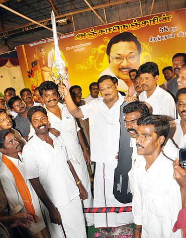 Alagiri with supporters in this dated picture