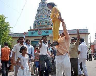 People in Ralegan Siddhi celebrate after Anna Hazare decides to break his fast unto death against corruption on Saturday
