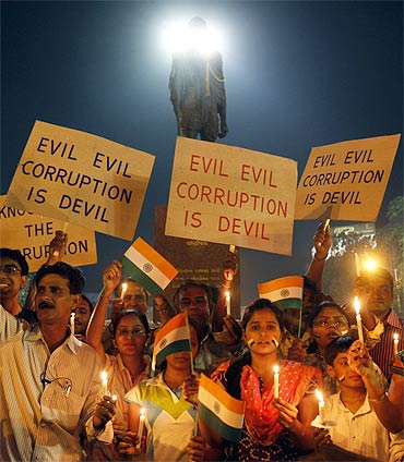 Hazare's supporters participate in a candlelight vigil against corruption in Ahmedabad