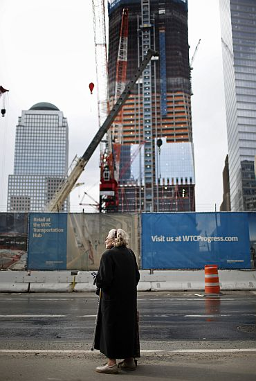 A woman stands on a sidewalk near the World Trade Center Site in lower Manhattan as construction on site continues (Image for representational purposes only)