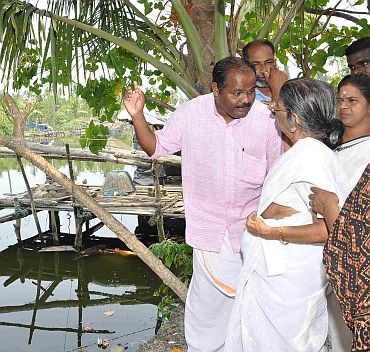 Gowri Amma listens to problems in the Tsunami colony