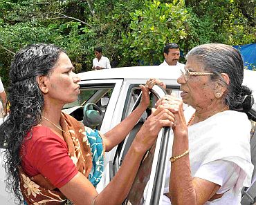 Gowri Amma talking to a voter, as she gets ready to leave for her next campaign venue