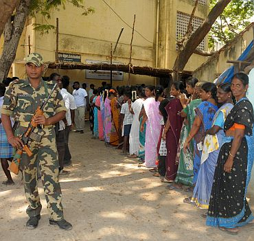 A long queue of female voters at a polling booth in Ozhukarai constituency in Puducherry