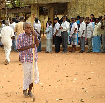 An old man arrives at a polling booth in Sorapet, to cast his vote in Puducherry
