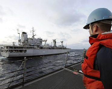 A Sailor attached to the guided-missile destroyer USS Stethem (DDG 63) watches as the Indian fuel tanker INS Jyoti (A 58) pulls alongside during a simulated replenishment-at-sea operation as part of exercise Malabar 2011