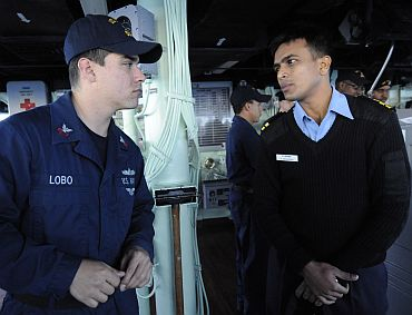 Indian Navy Liaison Officer LT K Srinivasan speaks with Quartermaster 1st Class Carlos Lobo about bridge wing operations aboard the guided-missile destroyer USS Stethem (DDG 63), as part of exercise Malabar 2011