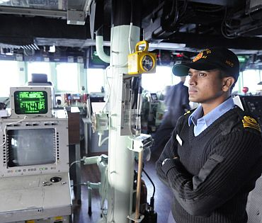 Indian Navy Liaison Officer Lt K Srinivasan observes bridge wing operations aboard the guided-missile destroyer USS Stehem (DDG 63), as part of exercise Malabar 2011