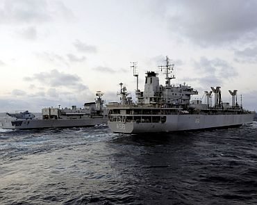 The Indian navy fuel tanker INS Jyoti (A 58) and guided-missile destroyer INS Delhi (D 61) sail side-by-side as part of exercise Malabar 2011