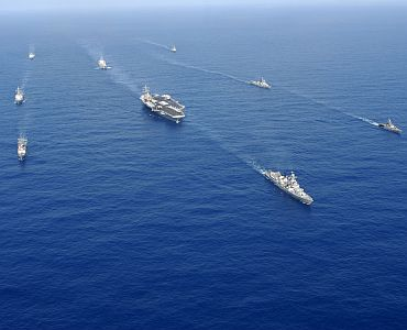 Aircraft carrier USS Ronald Reagan (CVN 76) and ships from Ronald Reagan Strike Group transit the Pacific Ocean in a nine ship formation with the Indian Navy