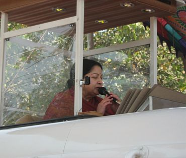 Jayalalithaa addresses the crowd from the top of her van