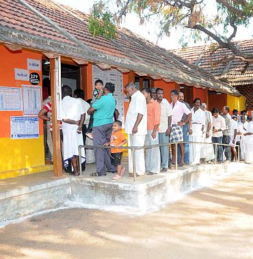 Voters in a queue at a polling booth to cast their vote at Kanyakumari