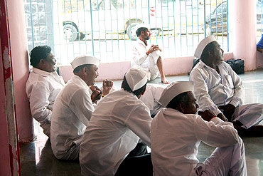 Villagers in Ralegan Siddhi wait to talk to Anna Hazare inside a temple