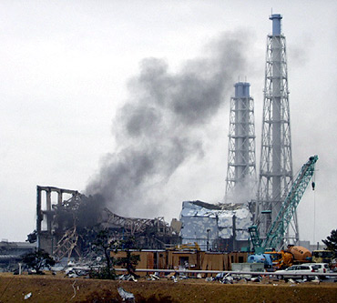 Smoke is seen coming from the area of the No 3 reactor of the Fukushima Daiichi nuclear power plant