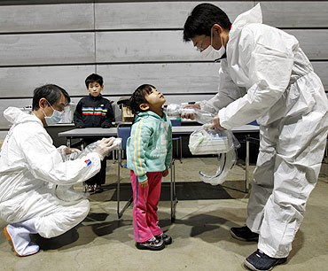 A five-year-old is being tested for possible radiation exposure at an evacuation center in Koriayama, Fukushima Prefecture