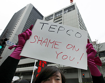 An anti-nuclear protester outside the TEPCO headquarters