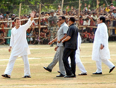 Rahul Gandhi waves to the crowd gathered for his rally in West Bengal