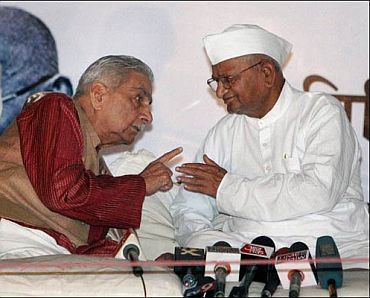 Noted lawyer Shanti Bhushan talks with social activist Anna Hazare