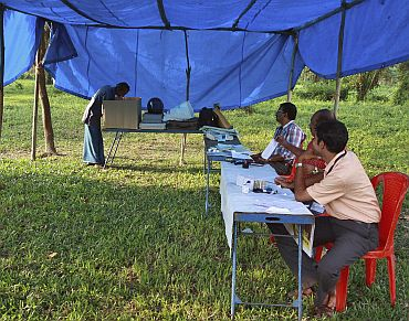 A man casts his vote at a temporary polling booth on Ramanthuruthu Island during the state assembly election in Kerala on April 13