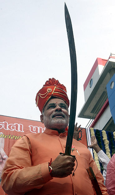 Narendra Modi holds a sword before filing his nomination papers for the 2007 assembly elections in Ahmedabad