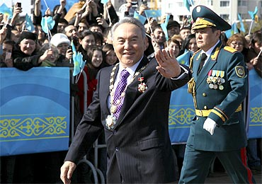 Kazakh President Nursultan Nazarbayev waves to supporters