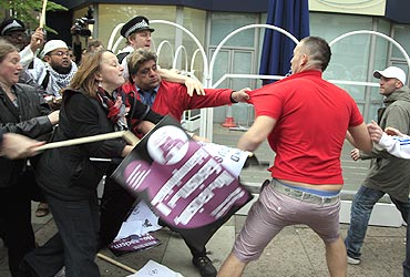Demonstrators from the far-right English Defence League clash with supporters of full-face veils