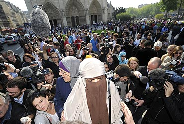 Kenza Drider, a French Muslim woman, is seen outside a cathedral in Paris
