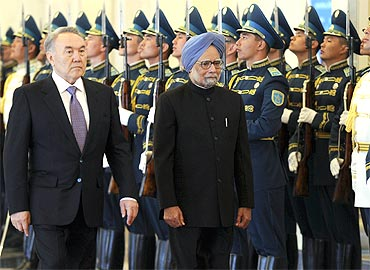 President Nazarbayev and PM Manmohan Singh inspect the guard of honour during their meeting in Astana on Saturday