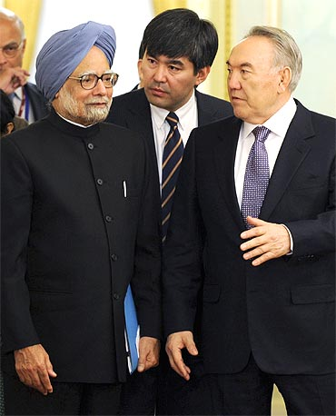 President Nazarbayev talks to PM Manmohan Singh during their meeting in Astana on Saturday