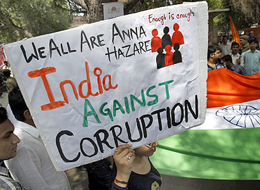 A supporter of social activist Anna Hazare holds up a sign during a campaign against corruption.