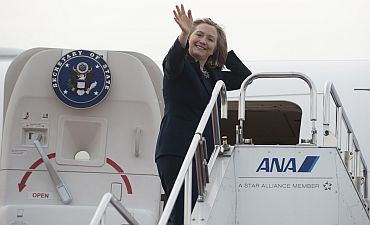 US Secretary of State Hillary Clinton waves prior to departing Haneda Airport in Tokyo