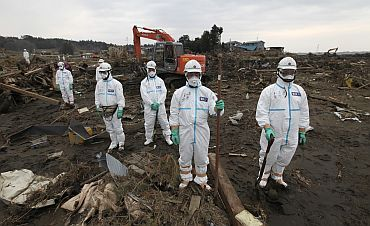 Police officers in protective suits near Fukushima