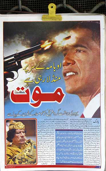 The frontpage of  a newspaper reads: Death is flying over Obama's head